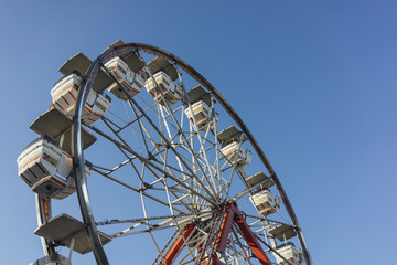 Ferris wheel against a blue sky at a carnival