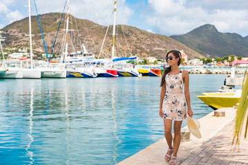 Wall Mural - Woman tourist walking in Philipsburg harbor, St Maarten, popular port of call for cruise ship travel destination. Netherlands Antilles.