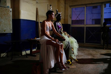 Models Linet Lau and Yilia Placido wait to perform at the Carnival in Havana, Cuba
