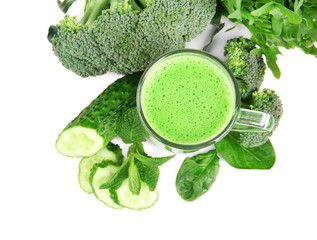 Glass of green healthy juice with vegetables on white background