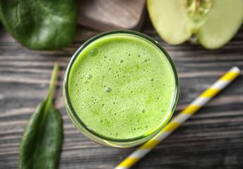 Glass of green healthy juice, closeup