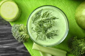 Glass of green healthy juice with vegetables, closeup