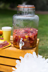 Decoration, lemonade jar, plate with fruits, plate with cheese and salami