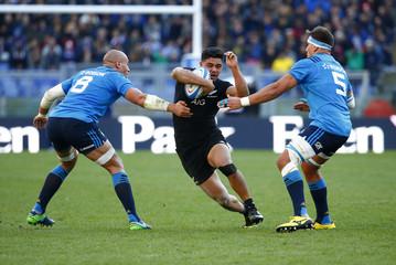 New Zealand's Anton Lienert-Brown in action with Italy's Dries van Schalkwyk and Sergio Parisse