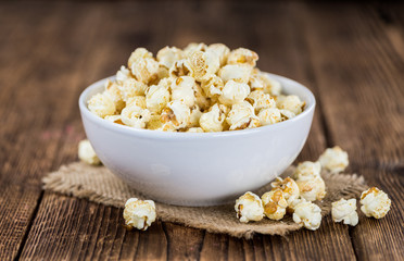 Popcorn on wooden background; selective focus