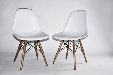 White color chair plastic in studio.
