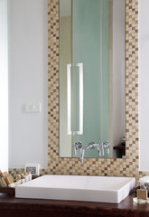 White washbasin and Gift Bath in clean restroom.