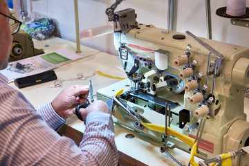 Tailor at work with sewing machine