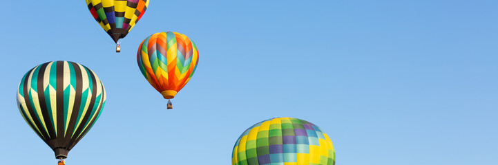 Hot air balloons up in the blue sky