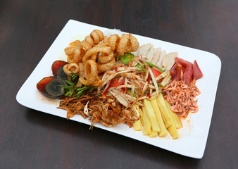 Thai spicy papaya salad serve with preserved egg, shoot, pork rind and crab.