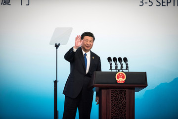 Chinese President Xi Jinping waves after holding a press conference at the BRICS Summit in Xiamen