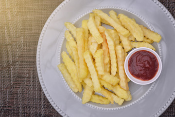 Top View French fries on plate with ketchup , light effect.