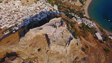 Photo sur Aluminium Aerial drone photo of famous beach of Lindos with turquoise waters and iconic ancient Acropolis - village of Lindos, Rodos island, Aegean, Dodecanese, Greece