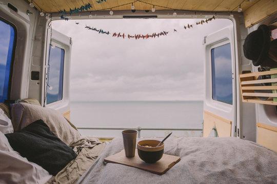 Breakfast by the sea inside a camper van