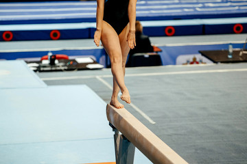 competition in artistic gymnastics balance beam woman gymnast