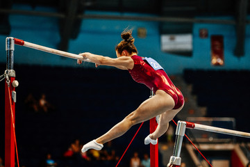 Fotorolgordijn Gymnastiek uneven bars female gymnast to competition in artistic gymnastics