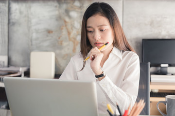 New generation business woman is working with a notebook,Asian female are stressed working in the office