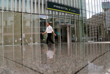 A man walks past a branch of Sumitomo Mitsui Banking Corp (SMBC) Trust Bank in Tokyo