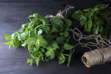 Fresh mint leaves herb on dark table.