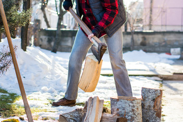 Man cutting firewood for the winter