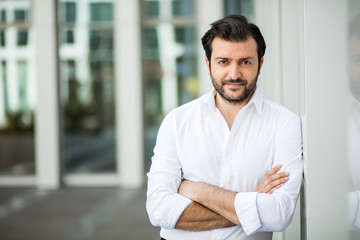 elegant man in white shirt outside
