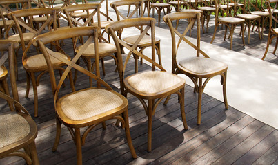 Wooden chairs set row orderly on the terrace.