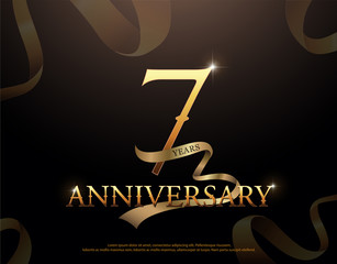 7 year anniversary celebration logotype template. 7th logo with ribbons on black background