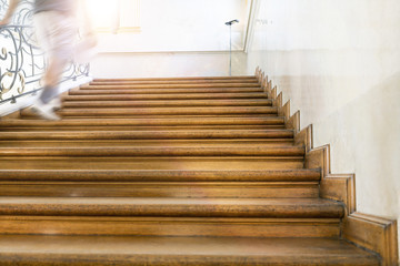 motion blur, man goes upstairs, old wooden stairs