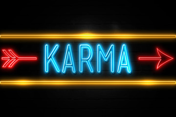 Karma  - fluorescent Neon Sign on brickwall Front view