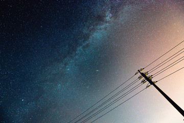 abstract night sky with milky way and star over the silhouette power line