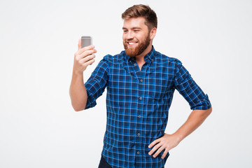 Picture of Smiling bearded man in checkered shirt