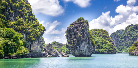 cruising among beautiful limestone rocks and secluded beaches in Ha Long bay, UNESCO world heritage site, Vietnam