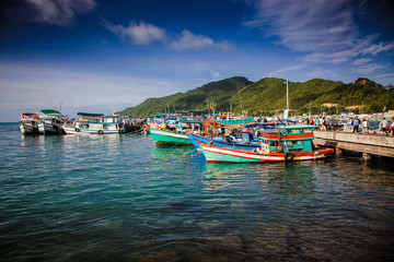 traditional colorful Vietnamese fishing boats in the main port of Nam Du Islands, Kien Giang, Vietnam. Nam Du has become a popular tourist attraction, but foreigner are only allowed in with a permit.