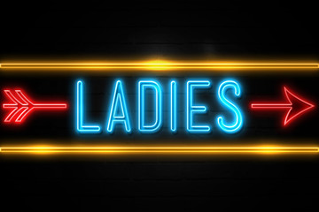 Ladies  - fluorescent Neon Sign on brickwall Front view
