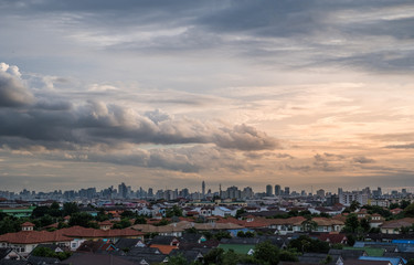Sunset with cloudy sky over the city