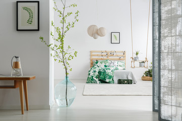 Bedroom with branch in vase