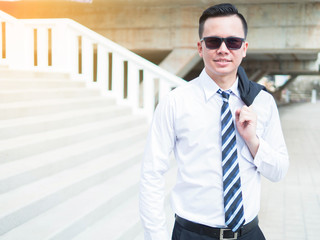 Businessman in formal wear and sunglasses outdoor