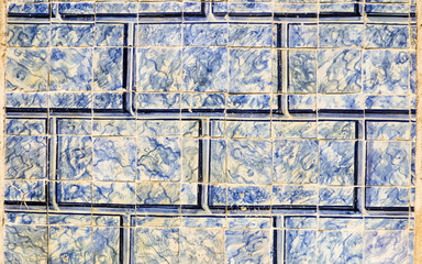 Blue Portuguese tiles (azulejos) shaped and drawn to look like bricks in Lisbon, Portugal
