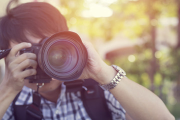 close up of Travelling Asian people photographer take photo