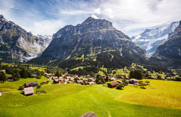 Wall Mural - Impressive view of alpine Eiger village. Popular tourist attraction. Location place Swiss alps, Grindelwald valley, Europe.