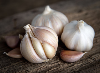 garlic bulbs with garlic cloves on wooden.
