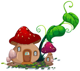 Mushroom house with green leaves