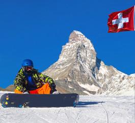 Swiss beauty, snowboarder under Matterhorn,Zermatt,Valais,Switzerland,Europe