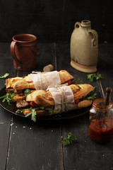 Delicious sandwich with meat with arugula and tomatoes