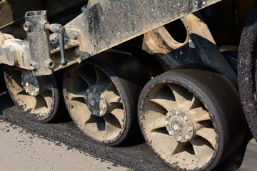 Close up of road grading machine wheels at construction site for new shopping center
