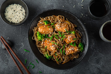 teriyaki salmon and soba noodle served with sesame seeds and chives