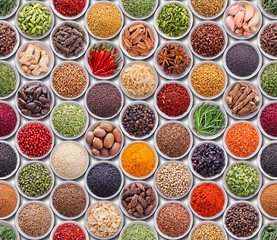 Fototapete - Bright colorful seamless texture with spices and herbs over whit