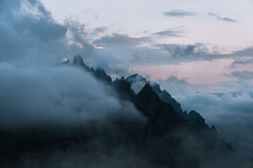 Dolomites mountains during sunset covered in clouds