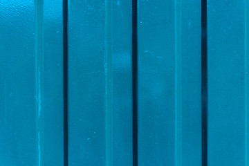 blue metal wall with horizontal lines