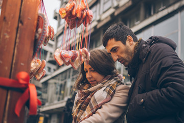 Couple shopping on a Christmas Day at the street festival